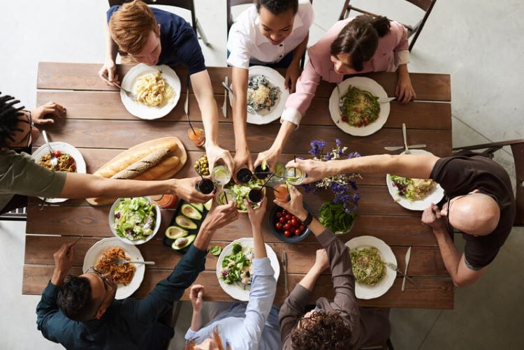 New Homeowners Celebrating with Family at dinner table
