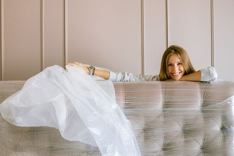 Woman Smiling Behind the Headboard