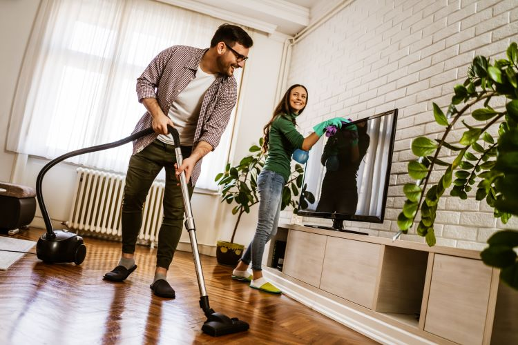 Couple Cleaning Their Home For Rent