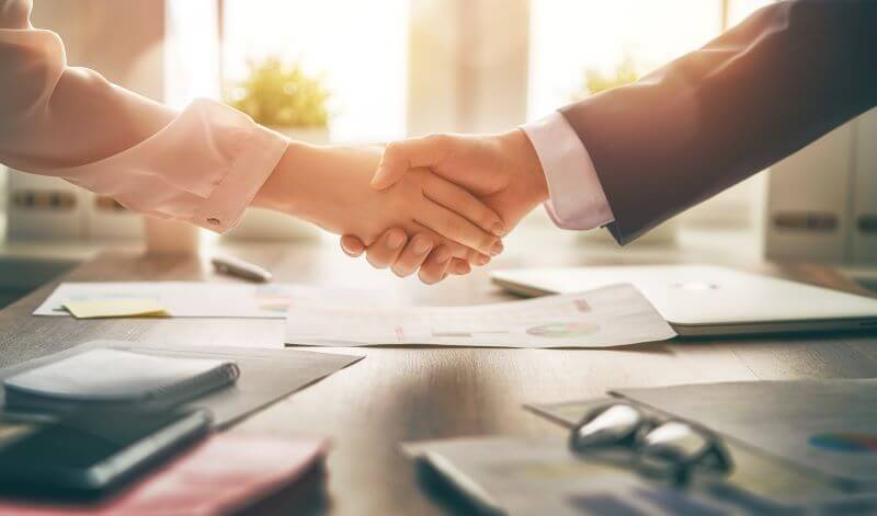 Shaking Hands for Exclusive Right to Rent Agreement
