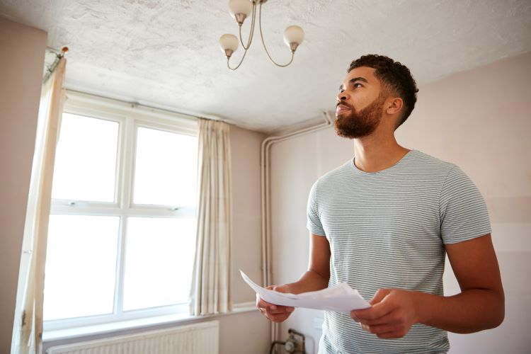 Man planning rehab of first investment property